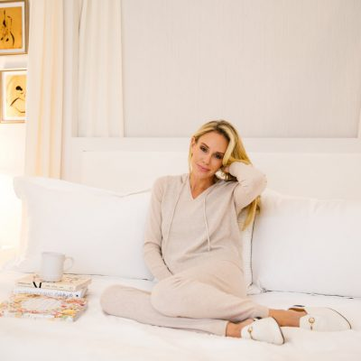 Blonde-woman-sitting-bed